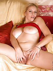 Busty Anilos milf exposes her delectable pussy as she teases it with her talented fingers