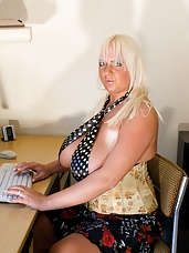 Big natural euro tits Emilia Boshe tweaks her masive juggs at the office and then starts tweaking her twat