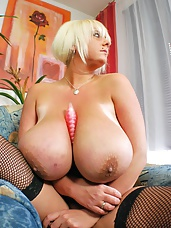 Europes biggest bust babe Emilia Boshe plays with her big natural boobs and pounds her pink pussy with her vibrator
