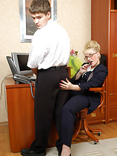 Hot mature business woman bending over in hot quickie with young co-worker