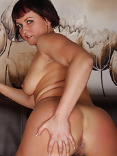 Naughty MILF playing with her wet pussy