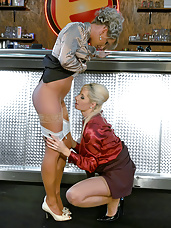 Clothed lesbians fondling