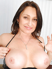 Busty Anilos Jillian Foxxx makes her magic wand slippery and rubs it on her pink clitoris
