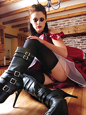 Brunette all dressed up in kinky gear fucks