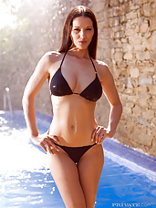 Sunburned bikini babe Angel Dark by the pool