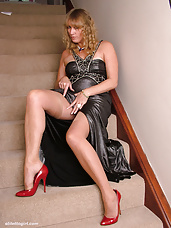Hot leggy Milf Melinda flashes her shiny stockings and sexy red stilettos