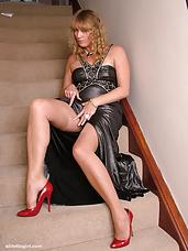 Hot leggy Milf Melinda flashes her shiny stockings and sexy red stilettos