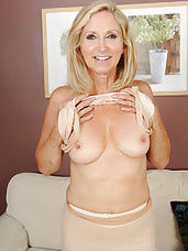 Sexy blonde Annabelle slips off her stockings revealing her hot body